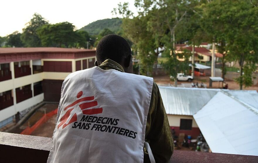 A member of Doctors Without Borders looks out over the general hospital in the Central African Republic's capital city, Bangui, in April 2014.