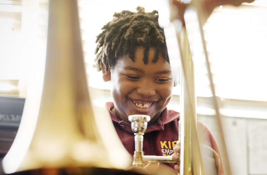 Amir Pinkney-Jengkens, 8, is learning trombone through Harmony Project, a nonprofit that provides musical instruments and instruction to children in low-income communities. Recent research suggests that such musical education may help improve kids' ability to process speech.
