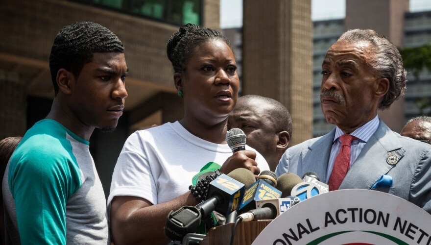 Sybrina Fulton, mother of Trayvon Martin, and Martin's brother, Jahvaris Fulton, attend a rally organized by Al Sharpton in New York on Saturday.