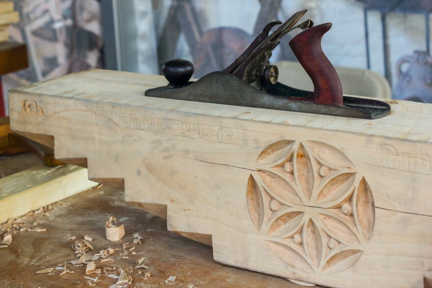 """A close-up of the beam that would be placed on top of the """"mother pillar"""" in an Armenian home."""