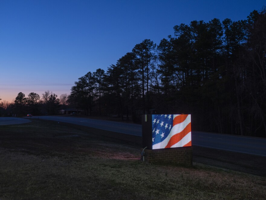 A sign outside Nottoway High School shows an animation of the American flag.