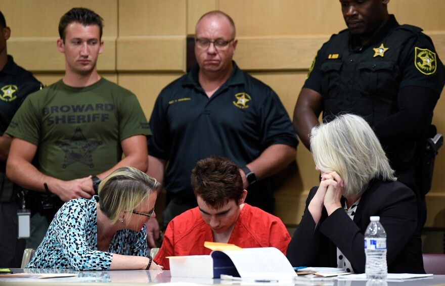 Nikolas Cruz has been represented by attorneys appointed by the Broward Public Defender's Office — but a judge is now weighing whether he can afford his own legal team. Cruz stands to inherit thousands of dollars.