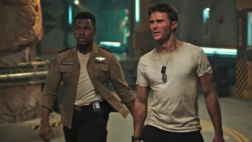 Jaeger Hot-Shots: Jake Pentecost (John Boyega) and Nate Lambert (Scott Eastwood) mech the most of a bad situation in <em>Pacific Rim Uprising</em>.