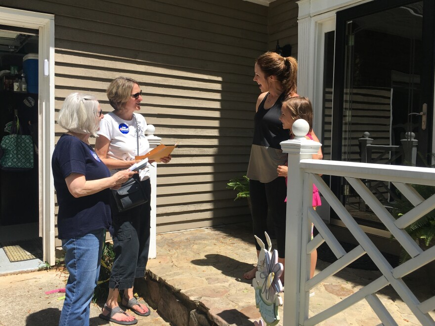 Christina Ferguson and Anna Cay Robertson canvass for Democrat Jon Ossoff ahead of Tuesday's special election in Georgia's 6th District. Megan Tucker tells them she is voting for Ossoff.