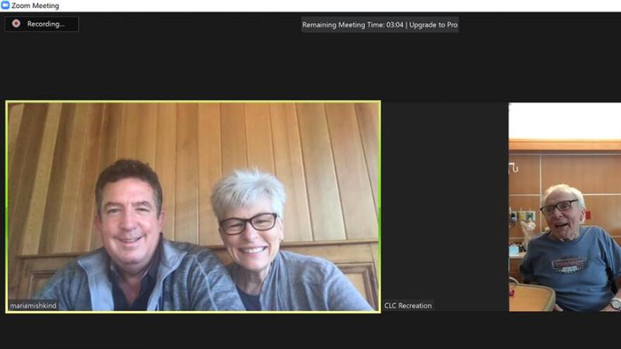 Veteran Harry Stapleton (right) does a video chat with his sister Maria Mishkind and her husband John.
