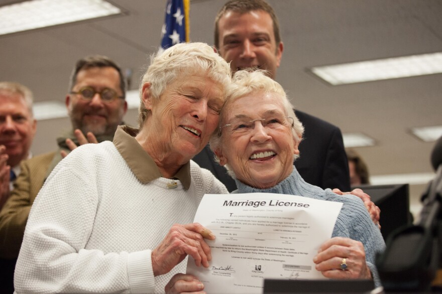 Jane Abbott Lighty, left, and Pete-e Petersen embrace after receiving the first same-sex marriage license in Washington state at the King County Recorder's Office in Seattle, Washington.
