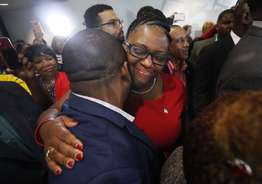 Allison Jean, center, the mother of Botham Jean, hugs a supporter after fired Dallas police officer Amber Guyger was found guilty of murder on Tuesday.