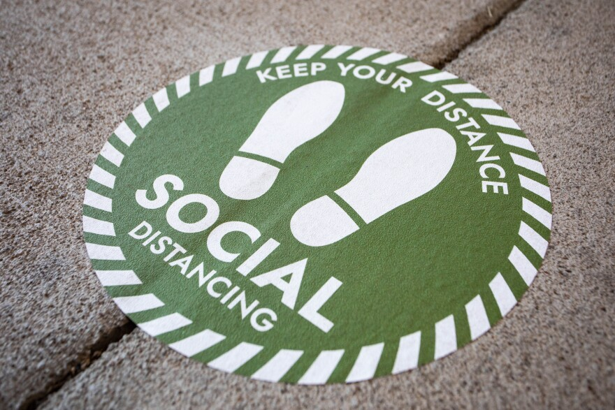 Social distancing signage outside the Palmer Events Center during the City of Austin's budget hearing on Aug. 12.