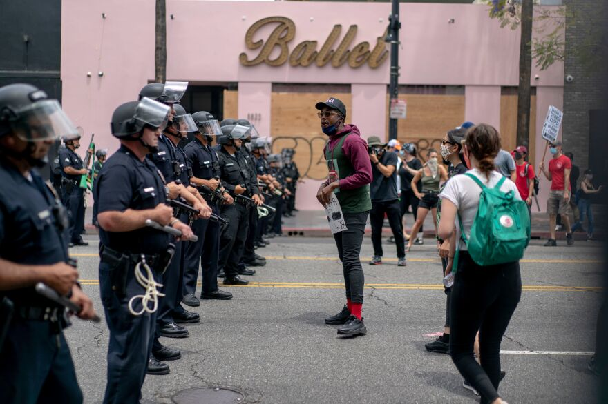 Protesters face police in Hollywood on June 2 during a demonstration over Floyd's death.