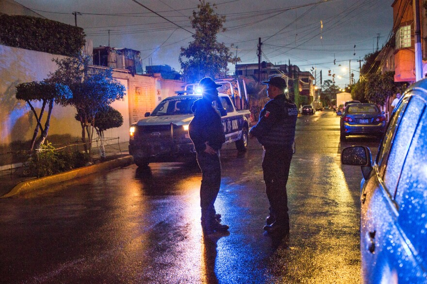 Alejandro García (left) and Agustin Ricardo Anaya, members of the local police force, investigate a stolen vehicle in the state of Mexico, part of the greater metropolitan area of Mexico City, in August 2017.
