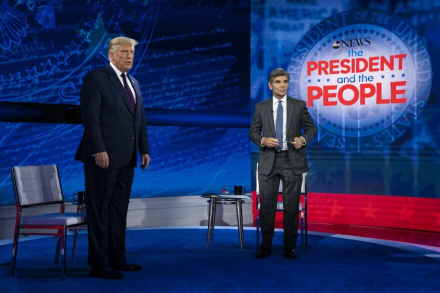 President Donald Trump on stage with ABC News anchor George Stephanopoulos