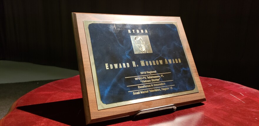 a plaque award sitting on the table