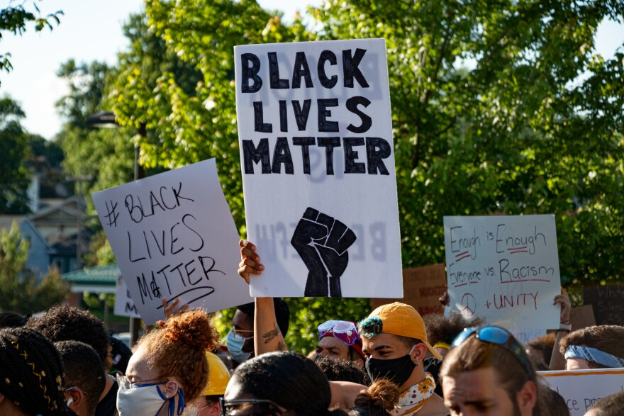 Demonstrators in Des Moines hold signs supporting the Black Lives Matter movement at a march on June 3, 2020.