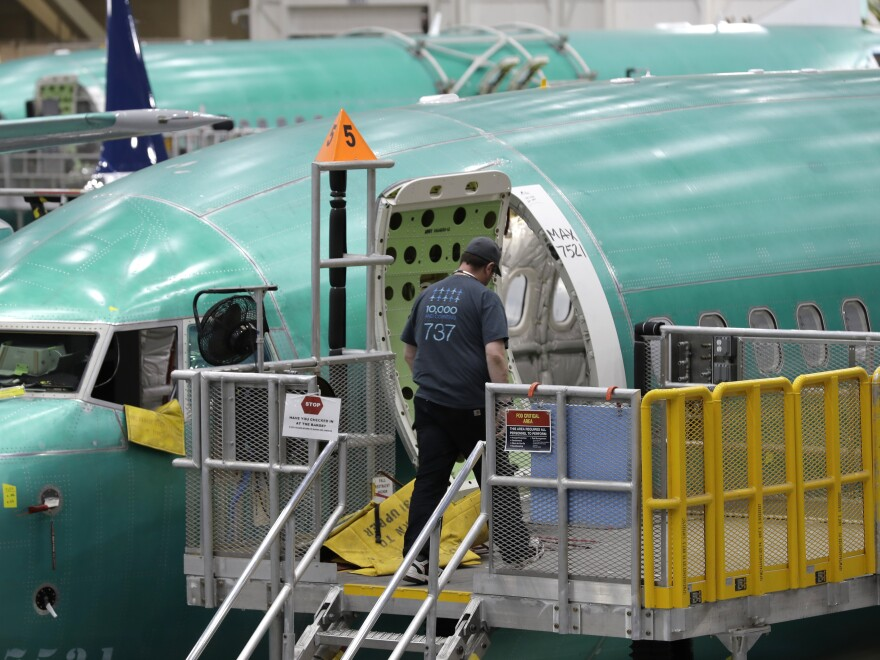 A Boeing 737 Max 8 airplane is shown on the assembly line during a brief media tour of Boeing's 737 assembly facility. The plane has been grounded since March, when the second of two deadly crashes involving the aircraft occurred.