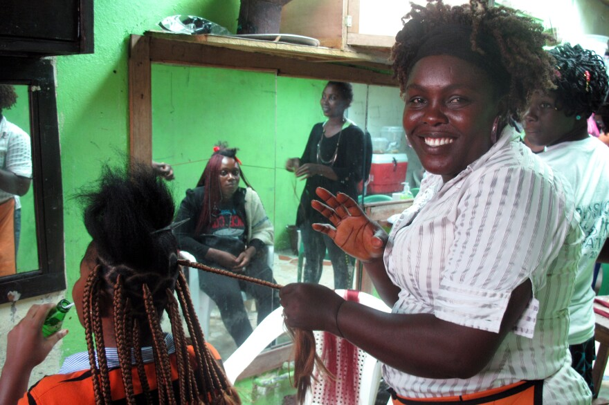 Angie Gardea depends on her job at a hair salon to put food on the table. But because of the Ebola outbreak, business has been slow. Customers are afraid to come in.