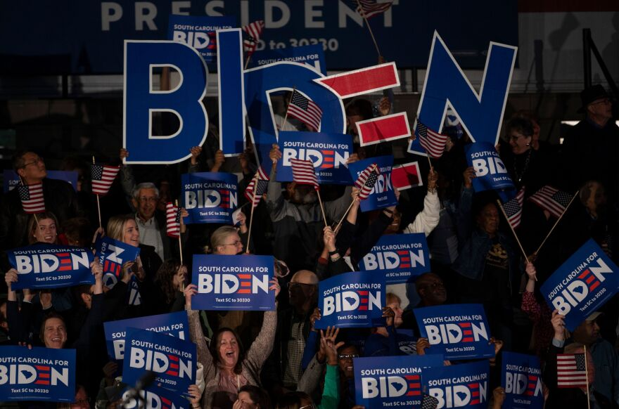 Supporters cheer as the polls close for Democratic presidential candidate Joe Biden at his primary night event in Columbia, S.C.
