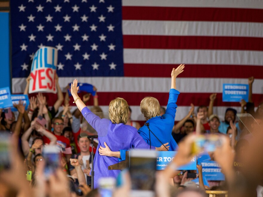 Sen. Elizabeth Warren (right) introduces Democratic presidential candidate Hillary Clinton at a rally at the Cincinnati Museum Center at Union Terminal on Monday.