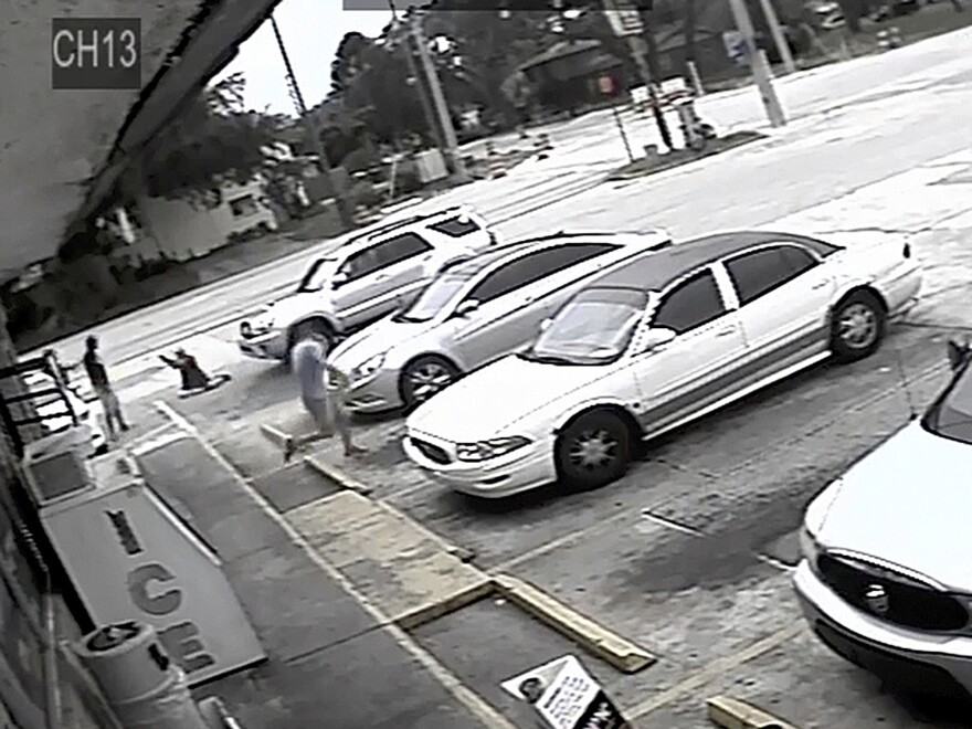 Surveillance image shows McGlockton (far left), an unarmed black man, being shot by Drejka, who is white, during an altercation in a Clearwater, Fla., parking lot in July 2018.