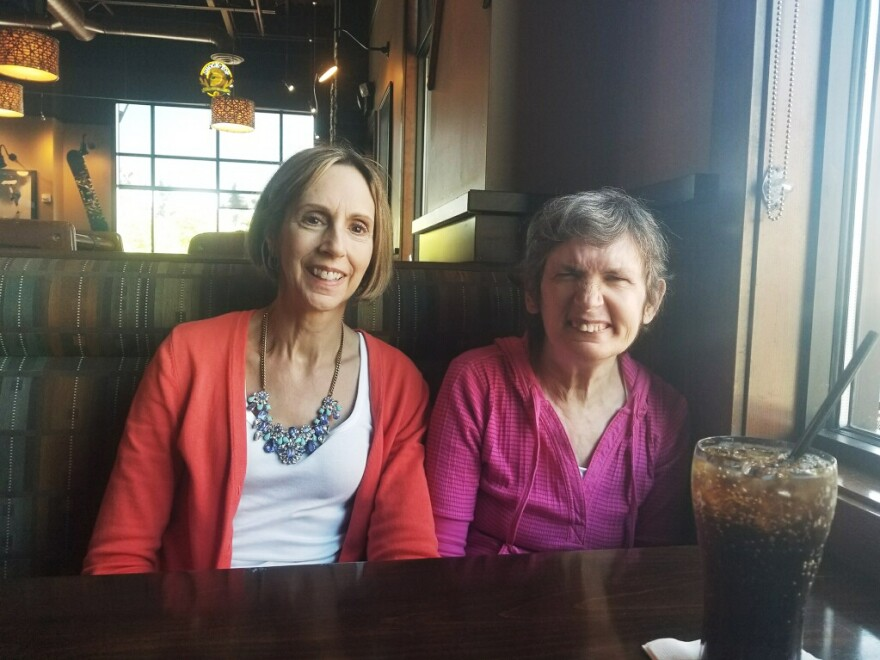 "Cathy McIvor (left) takes her sister, Maryann, out for a hamburger in Tacoma, Wash. ""Hamburger"" is one of a few dozen words Maryann can say with sign language."