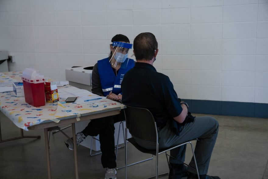 Brian Nickolay gets vaccinated for COVID-19 at the Gallatin County Fairgrounds, January 6, 2021.