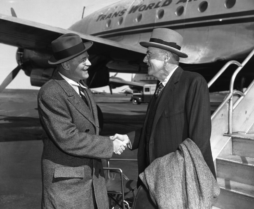 John Foster Dulles (right) is greeted by his brother Allen Welsh Dulles on his arrival at LaGuardia Field in New York City in 1948.