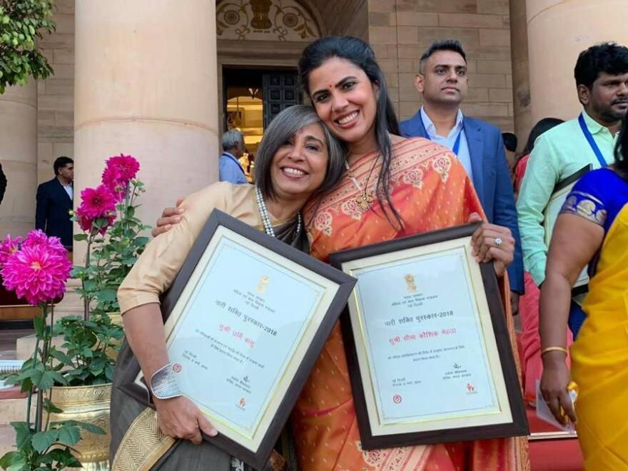 Urmi Basu, left, receives the Nari Shakti Puraskar award in New Delhi. It's India's highest honor for civilian women.