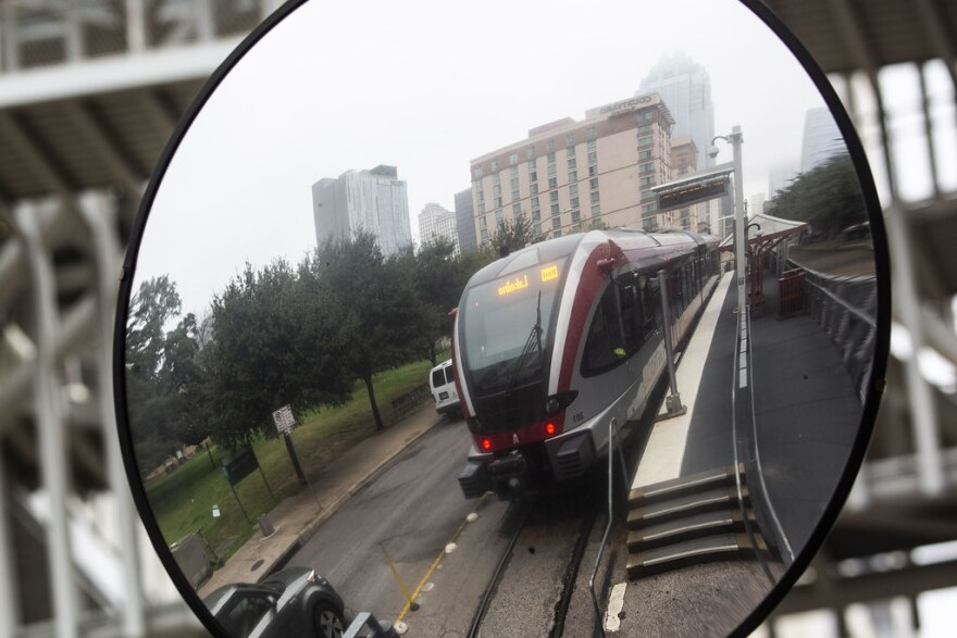 A Metrorail train is reflected in a mirror at the downtown Austin station.