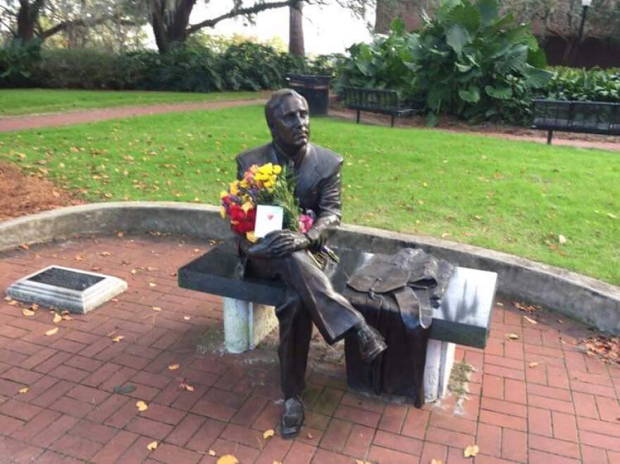 A floral tribute on the statue of T.K. Wetherell on the Florida State University campus.