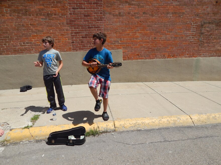 Yellow Springs resident Joseph Minde-Berman (right) plays music at street fairs for spare cash. He's pictured with his friend Corbin Rogers, also of Yellow Springs.