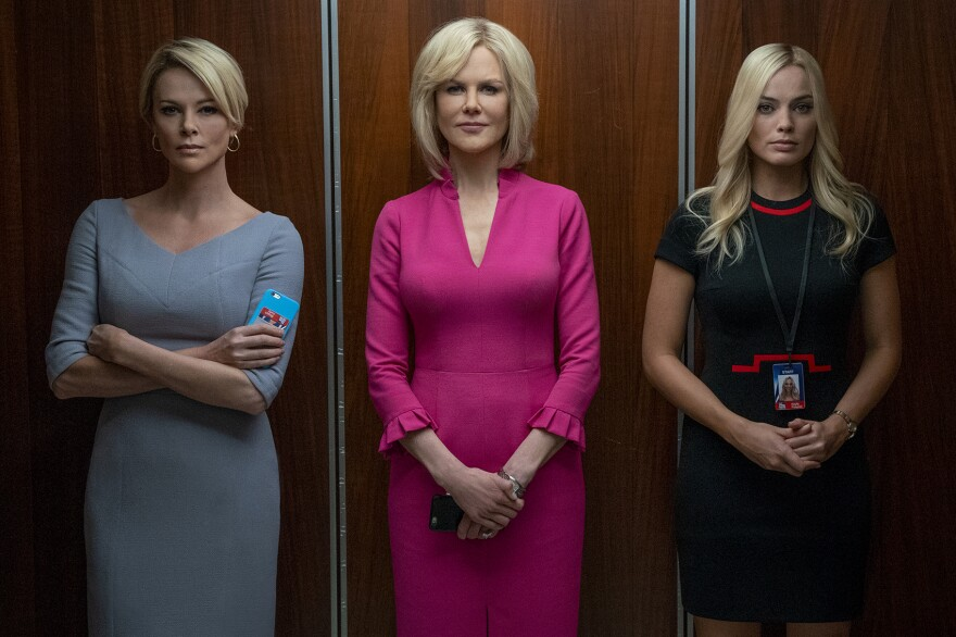 """Charlize Theron (left) as Megyn Kelly, Nicole Kidman (center) as Gretchen Carlson and Margot Robbie as fictional Fox News producer Kayla Pospisil in """"Bombshell."""" (Hilary Bronwyn Gayle SMPSP)"""