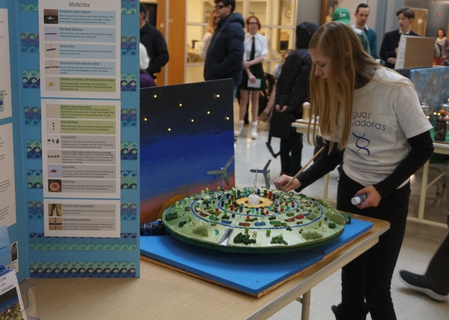 Kaitlin Taylor from Senn-Thomas Middle School puts the finishing touches on her team's model city for the Future City Competition. 1-25-20