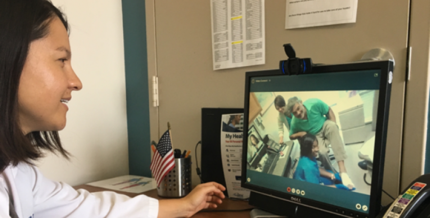 Dr. Leonie Heyworth facilitates a synchronous telehealth session with a veteran.