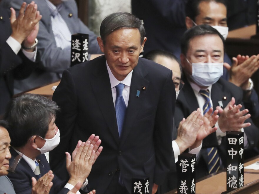 Yoshihide Suga receives applause Wednesday after being elected as Japan's new prime minister at Parliament's lower house in Tokyo.