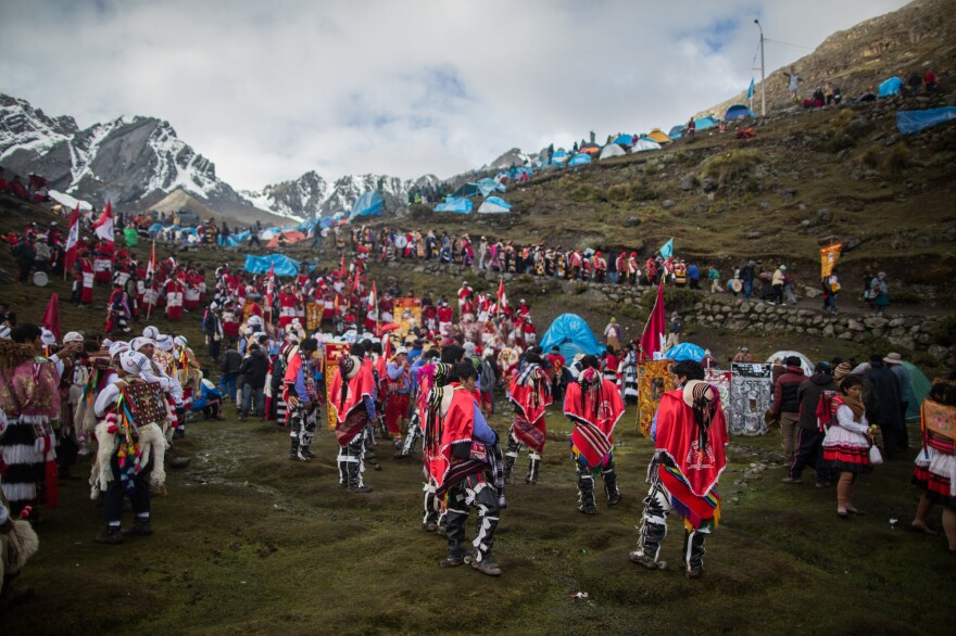 The yearly festival is called Qoyllur Riti — Snow Star in the Quechua language. Wearing traditional garb as well as special outfits made for the event, worshipers travel many miles by truck, then face a steep six-hour hike to get to the site.