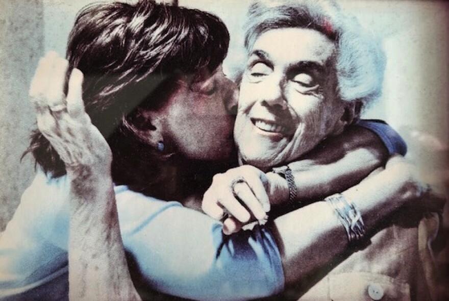 Rona Bartelstone kisses her mother Hazel Canarick on her cheek.