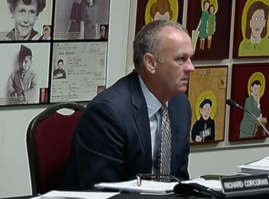 Richard Corcoran listens during a meeting