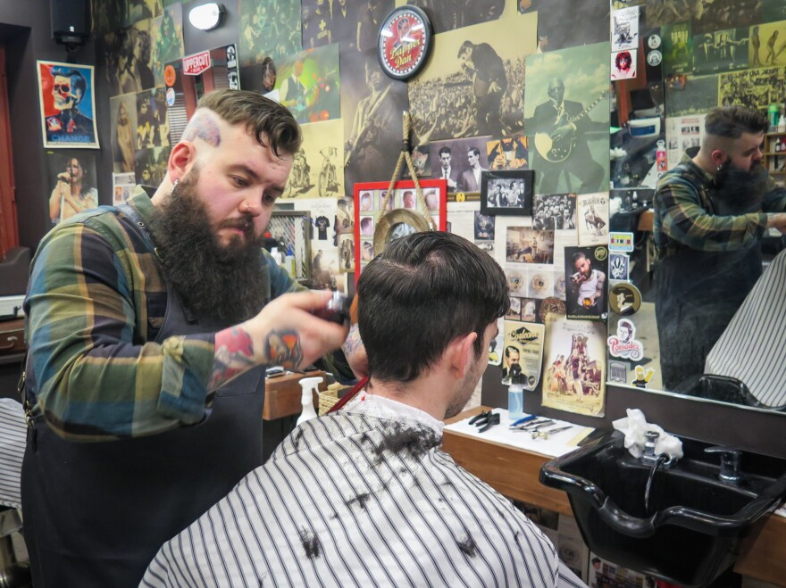 """""""Here in Moscow, it's still not very typical for people to wear head tattoos and piercing and beards,"""" says barber Artemy Zolotarevsky. """"When people see me, some are amazed, some give me mean looks. And so I think I'm a bit of an outlaw."""""""