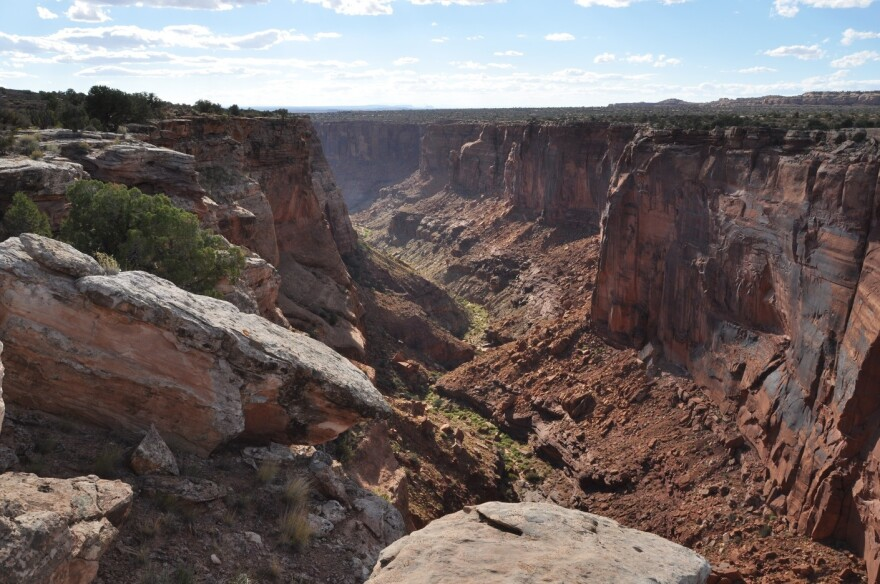 Looking into a steep red rock canyon