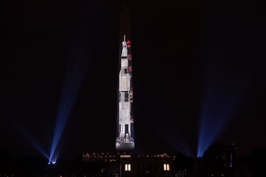 The Smithsonian celebrates the 50th anniversary of the Apollo 11 launch by projecting a 363-foot visual rocket.