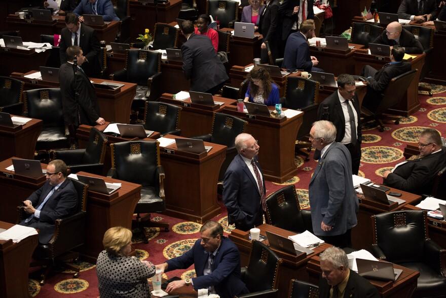 Missouri House of Representatives members speak on the house floor on the last day of the 2019 legislative session.