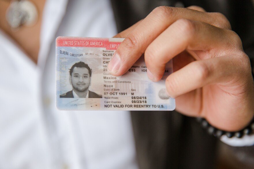 Christian Olvera, 26, a DACA recipient, shows his Employment Authorization Card, which expires later this year.