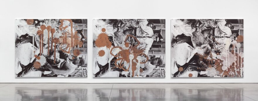 A art piece by Kelley Walker depicting a civil rights-era protest is splattered with melted dark, white, and milk chocolate.
