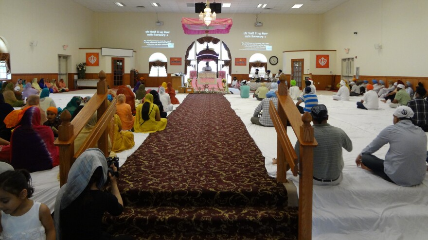 Worshippers at the Sikh Temple of Wisconsin in Oak Creek. The Aug. 5, 2012, shooting tragedy has brought some Sikhs closer to their faith.