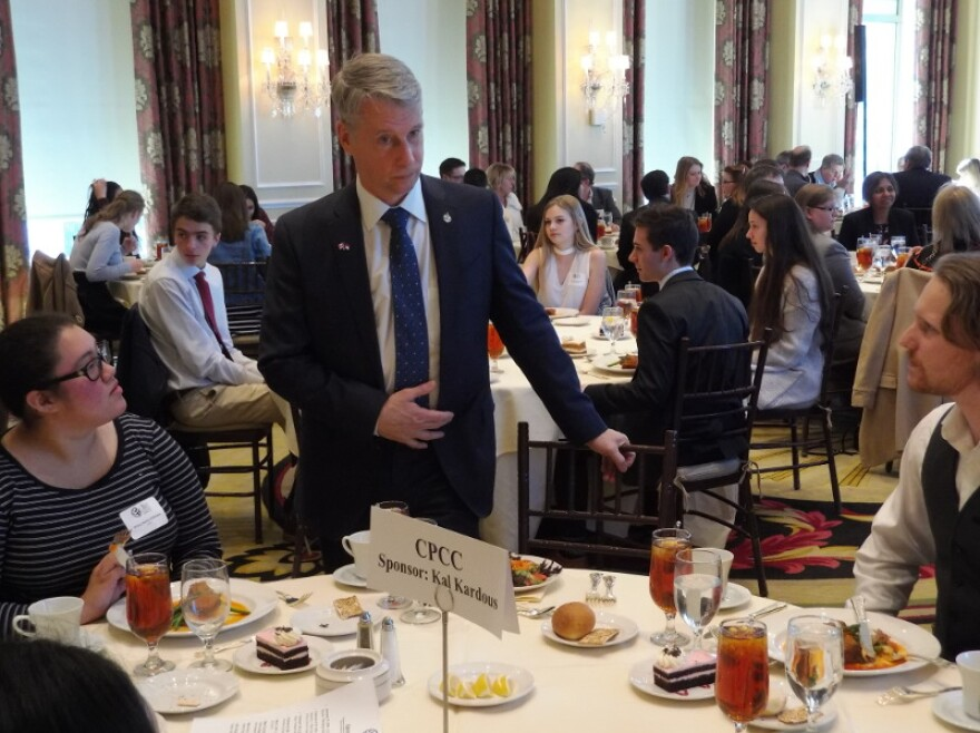 Andrew Leslie talked with a table of CPCC students before Thursday's lunch at the City Club.