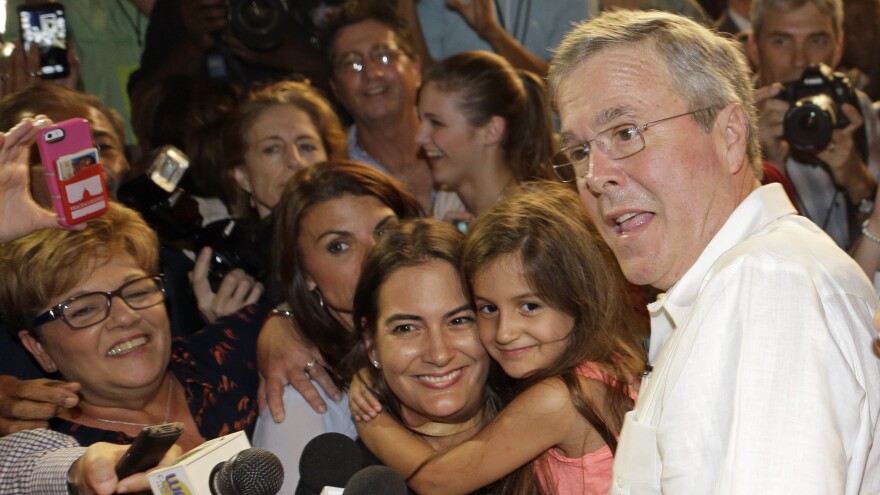 Former Florida Gov. Jeb Bush poses with supporters for photos during a fundraiser in May.