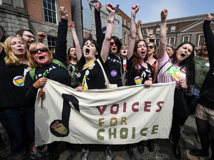 Supporters of Friday's referendum to repeal Ireland's abortion ban gathered at Dublin Castle on Saturday. Voters overwhelmingly chose to lift abortion restrictions by changing the country's constitution.