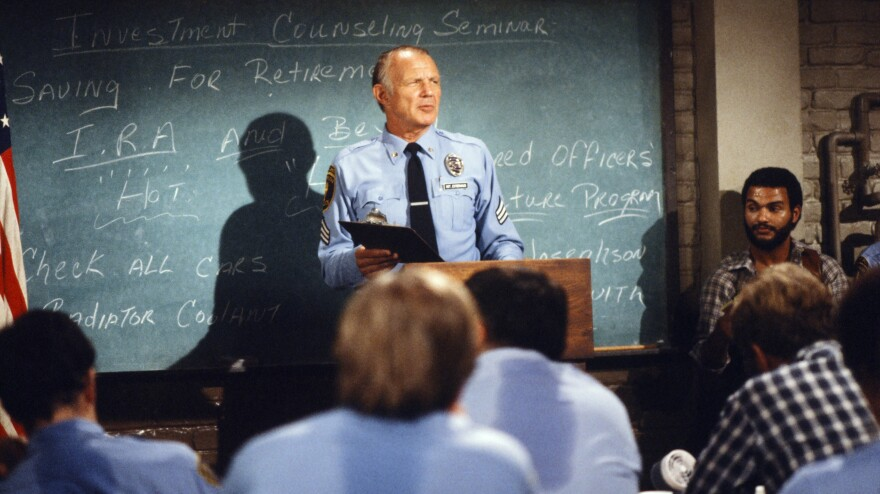 """Michael Conrad as Sgt. Phil Esterhaus does the cop roll call, concluding with his signature line: """"Let's be careful out there."""""""