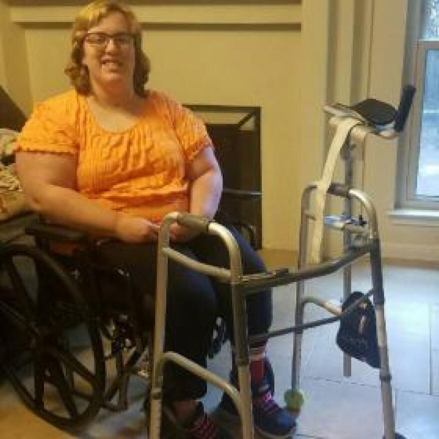 Whitney  Hardin uses a specialized walker to improve her mobility. It has a fixture to support her left hand and arm, which are partially paralyzed.