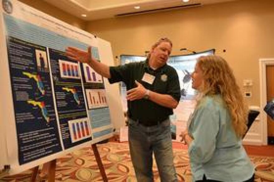 Someone giving an oral presentation during the 2013 Lionfish Summit hosted by FWC in Cocoa Beach, Florida.