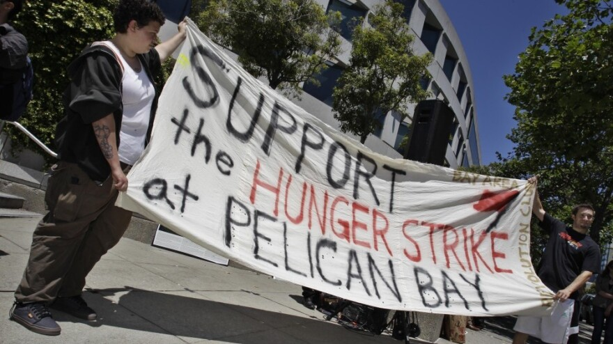 Demonstrators hold up a sign during a rally in front of the State Building in San Francisco on July 1 to support prisoners at Pelican Bay State Prison. Inmates in an isolation unit at the prison went on a hunger strike to protest conditions they describe as inhumane. The hunger strike later spread to other facilities.